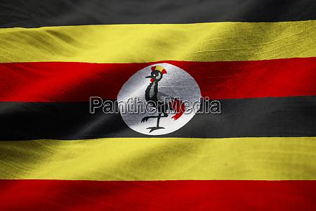 closeup of ruffled uganda flag uganda