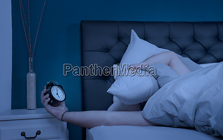 sleepless man hold his pillow and