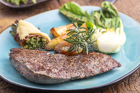 steak on a plate with vegetables