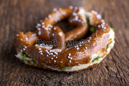 bavarian pretzel with butter on wood