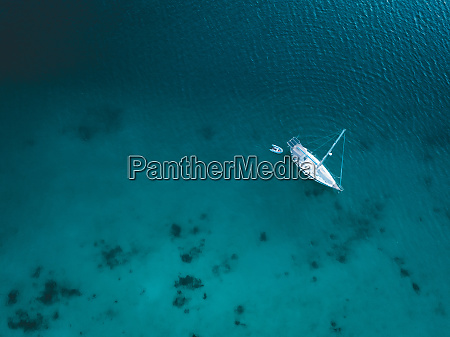 aerial view of yacht on blue