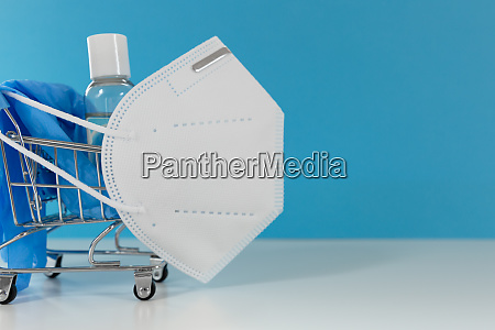 shopping cart with facial mask hand