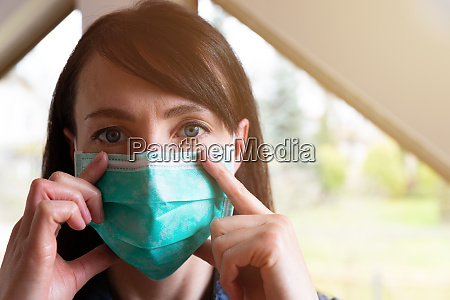 woman wearing facial protection mask in