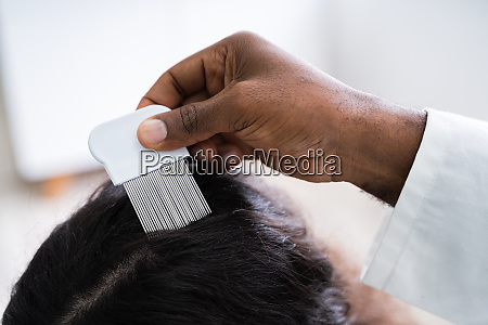 doctor doing treatment on hair