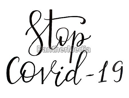 black handwritten inscription stop covid 19