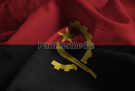 ruffled flag of angola blowing in