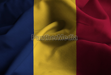 ruffled flag of chad blowing in