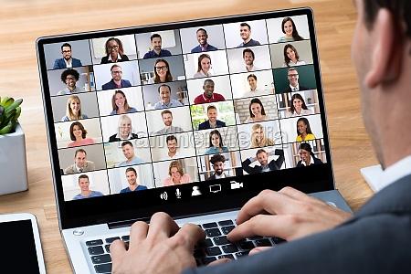 businessman giving online survey on laptop