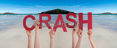 people hands holding word crash ocean