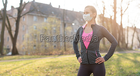 fit woman during health crisis exercising