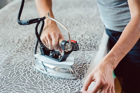 tailor ironing fabric