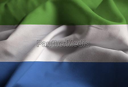 closeup of ruffled sierra leone flag