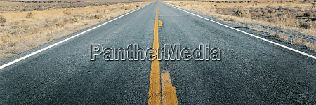 long straight road through desert empty