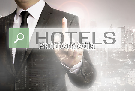 businessman with city background hotels browser