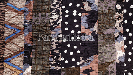 surface of handmade brown patchwork scarf