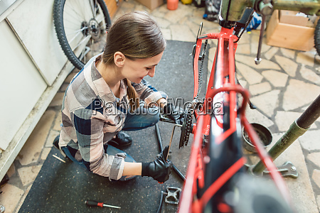 bike technician in her workshop working