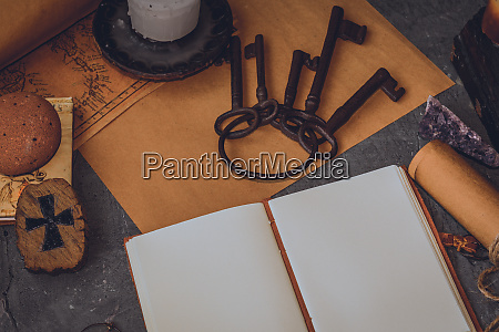 old keys and symbols in wood