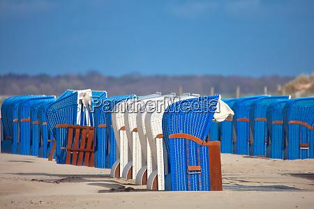 beach chairs on an empty beach