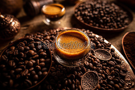 espresso shot and coffee beans