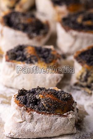 poppy rolls on a baking sheet