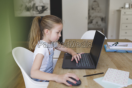 girl sitting in front of her