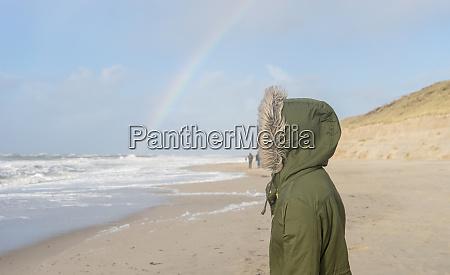 sea with a rainbow on the