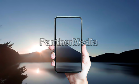 photographer holding smartphone for take photo