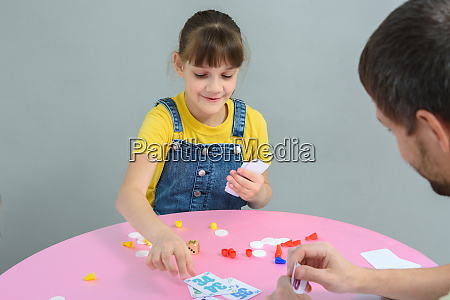 girl playing card board games with