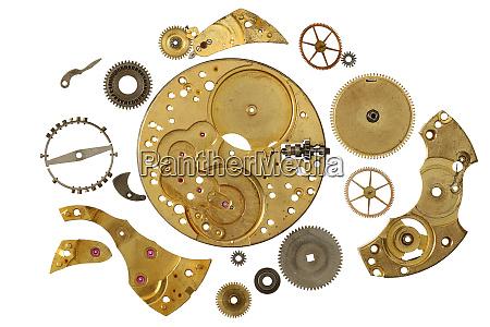 disassembled clockwork mechanism various part