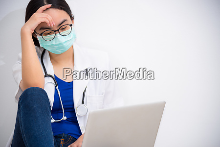 doctor looking at the laptop with