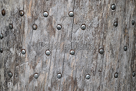 background texture nails hammered into tree