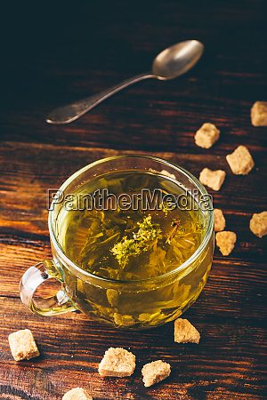 cup of herbal tea with refined