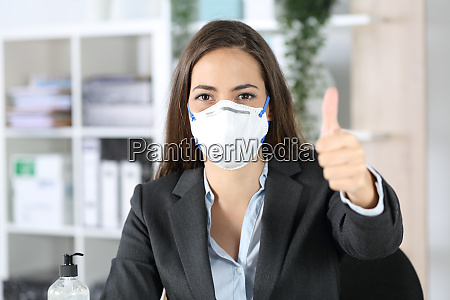 executive with mask with thumbs up
