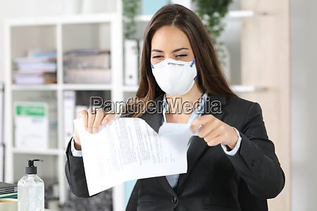 executive wearing mask ripping contract at