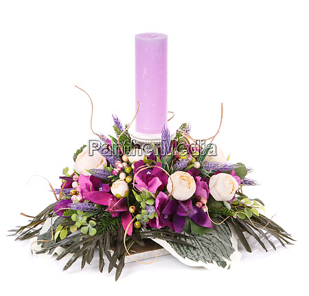 composition of flowers and candles to