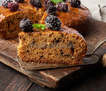 baked round sponge cake with nuts