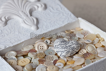 nostalgic buttons still life with heart