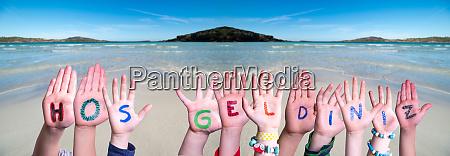 children hands building word hos geldiniz
