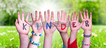 children hands building word kinder means