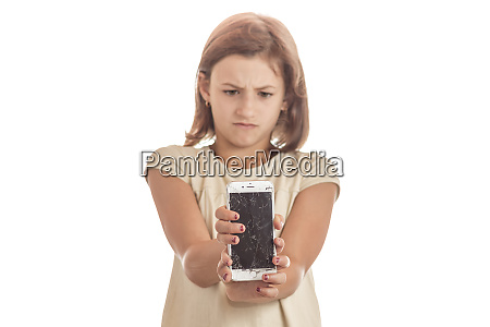 angry little girl holding an iphone