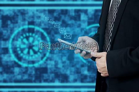 businessman sending mail via smartphone digital
