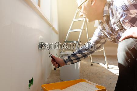 home improvement concept handyman painting a