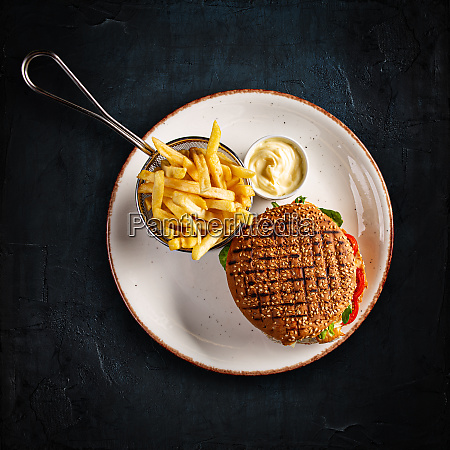 big cheeseburger with french fries