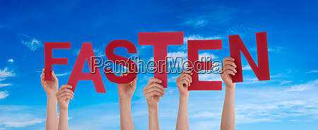 people hands holding word fasten means