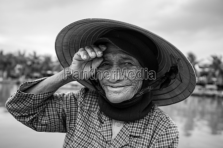 old woman with straw hat from