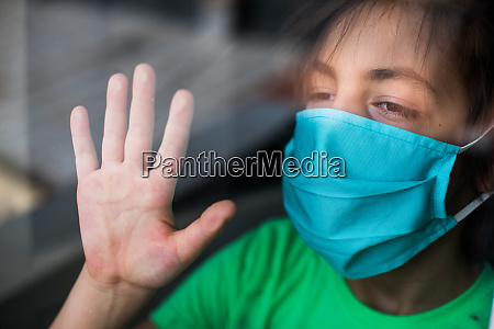 kid wearing a surgical mask