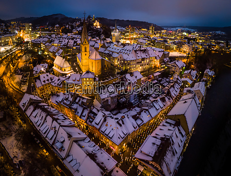 aerial view of snow capped roofs