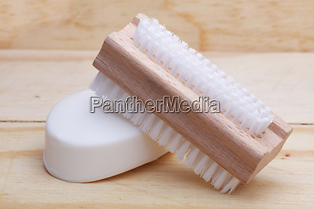 soap and nail brush on wood