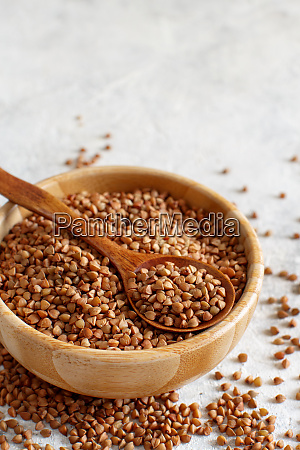 raw dry buckwheat grain in