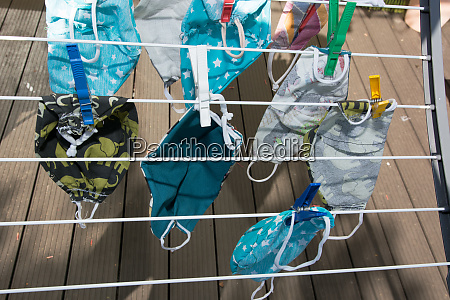 washed protection masks drying on a